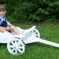 Charming Carriage painted white with aluminum banded wheels