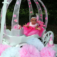 Large angel carriage, painted white with aluminum banded wheels
